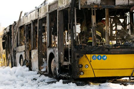 Burnt public traffic bus on street after caught in fire during travel and extinguished by firefighters