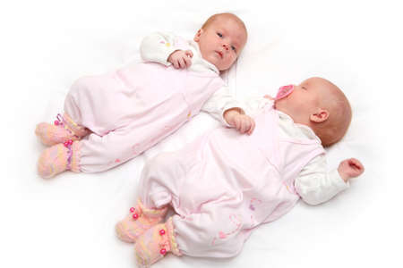 Portrait of two twin sisters, age two months photo
