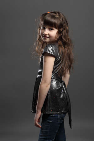 portrait of baby girl european exterior gray background photo