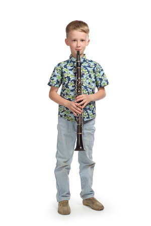 boy playing a clarinet isolated on a white background
