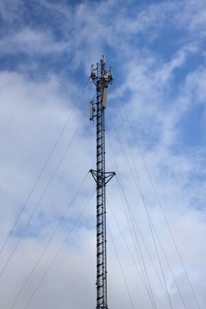 high frequency: The telecommunication tower in sky with clouds background Stock Photo