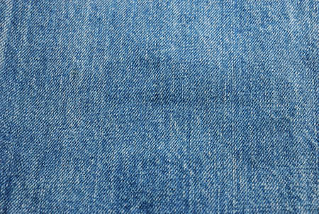 The fabric surface of jeans texture in blue color photo
