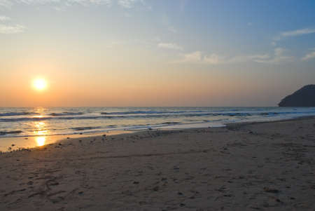 sunup: Scenic of sunset at the beach Stock Photo