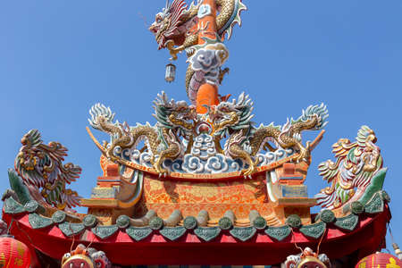 Dragons statue and mystical animal on Chinese temple roof photo