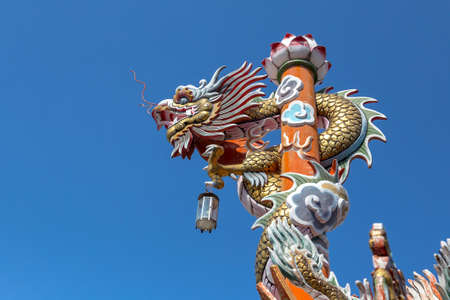 lamp on the pole: Chinese dragon statue on lamp pole Stock Photo