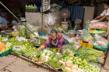 merchant: Samut Songkram, Thailand 2014 : Merchant sale vegetables in train market