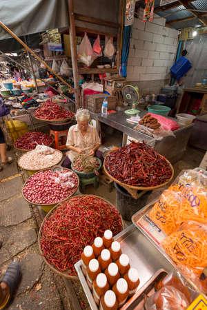 merchant: Samut Songkram, Thailand 2014 : Merchant sale chilli in train market
