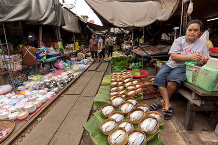 merchant: Samut Songkram, Thailand 2014 : Merchant sale their products in train market
