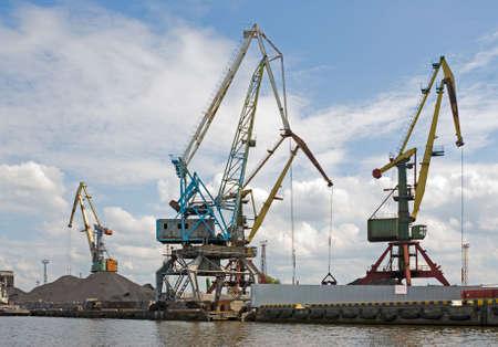 transposition: Bridge cranes at the sea port. Coal transshipment.