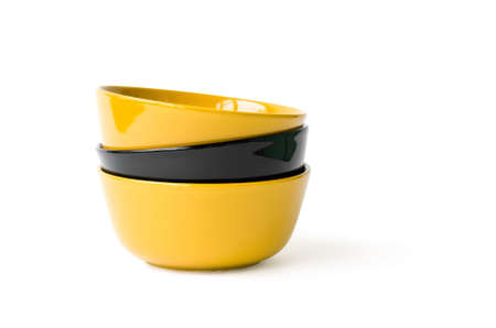 Three yellow and black bowls on the white background Stock Photo - 7311706