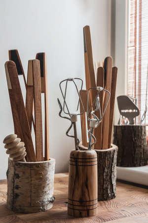 stirrer: Kitchen gadgets in beautiful wooden mugs. Stock Photo