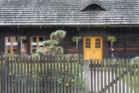 An antique wooden cottage with a log construction without remnants from 1831. Village Kielcza, Opole province, Poland, Europe.