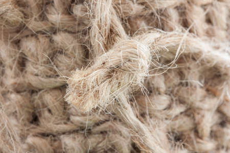 A knot of jute string isolated from the background. An ecological, natural product.