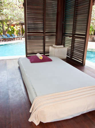 Beds for thai massage with pillows on them