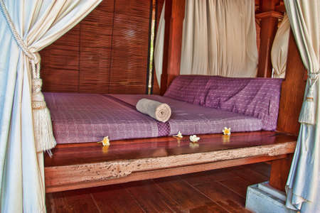 Beds for thai massage with pillows on them photo