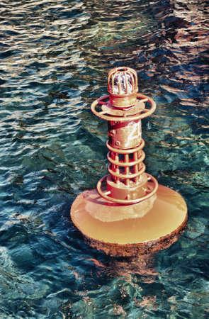 Red Marker Buoy in Sea retro look photo