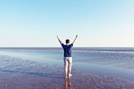 emotional freedom: energetic and satisfied man on the beach Stock Photo