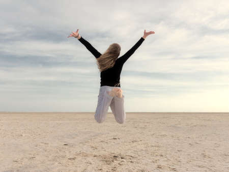 emotional freedom: energetic and satisfied woman on the beach