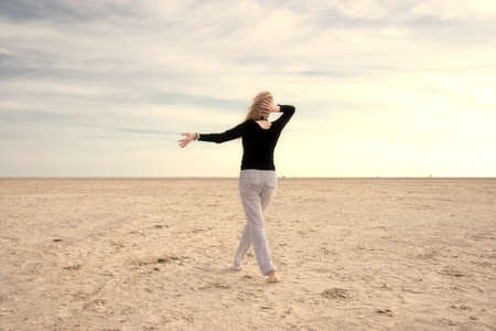 energetic and satisfied woman on the beach photo