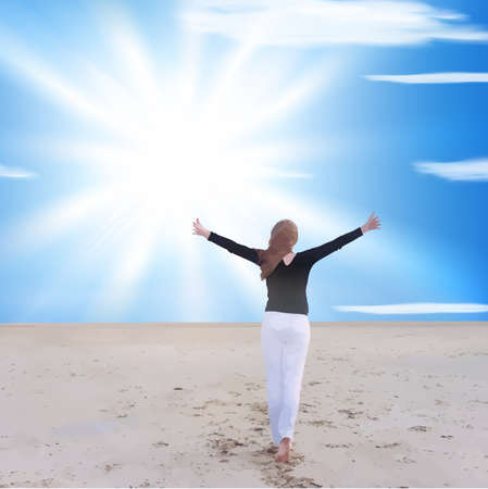 triumphant: energetic and satisfied woman on the beach