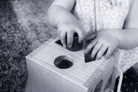 baby girl playing with wooden toys photo