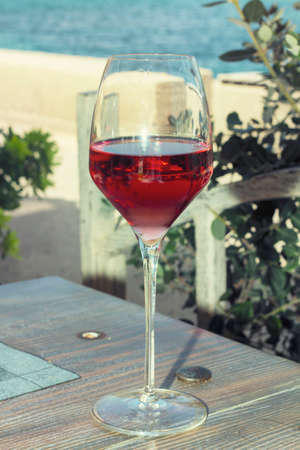 red wine pouring: Red Wine glass and Bottle
