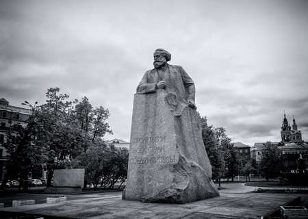 marx: Karl Marx statue on Revolution square in Moscow Editorial