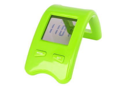reveille: Green digital alarm clock isolated on white background