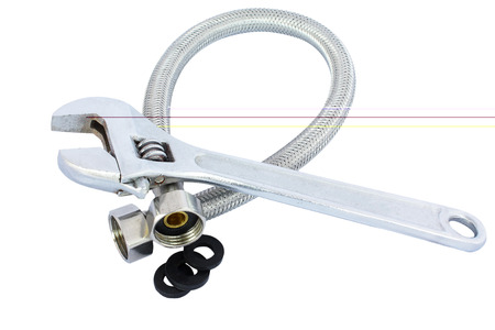 braided flexible: The water hose and wrench isolated on white background