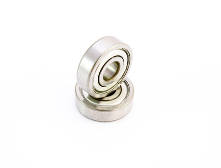 chromium plated: Rust ball bearing on white background Stock Photo