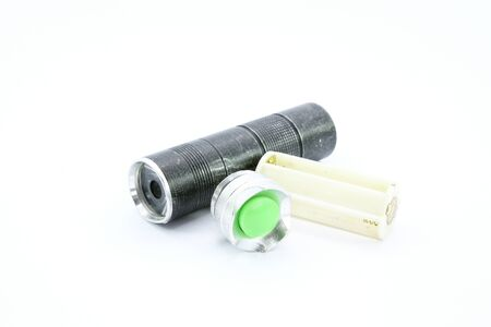cree: Old LED flashlight on white background Stock Photo