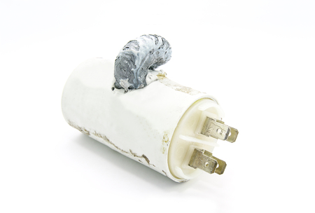 electrolyte: Broken capacitor on white background