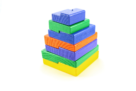 Colorful wooden pyramid toy on white background