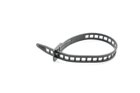 Black plastic cable tie on white background