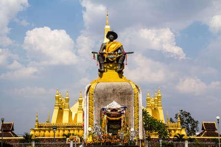 King Setthathirat statue and Golden pagada in Wat Pha-That Luang