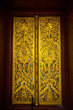 Beautiful Lao temple gate Stock Photo