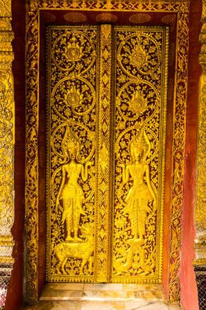 Traditional Lao style church door, Laos