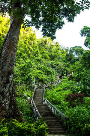 Stairs are lead to the cave at Vang Vieng, Laos