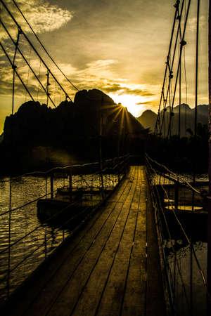Bridge over river song at sunset , Vang vieng, Laos Stock Photo
