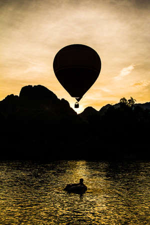 Balloon in the dawn of the day at Vang Vieng, Laos  Stock Photo