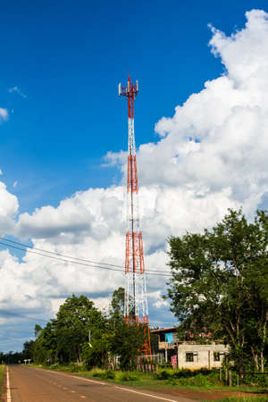 Cell phone and communication towers against blue sky photo