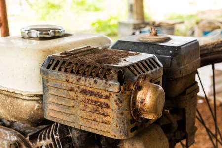 old rusty engine of lawnmower