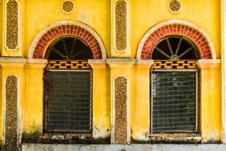 Vintage windows on old brick wall photo