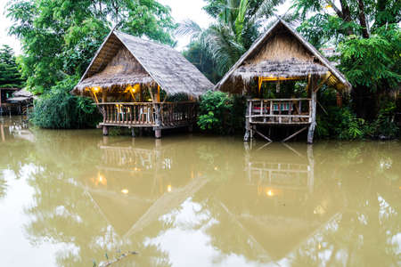 exotic huts in the lake, Thailand  Stock Photo
