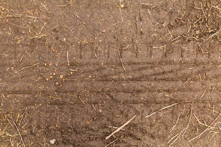 The trace of a tyre in the soil photo