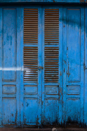 Blue wooden front door to the house Stock Photo