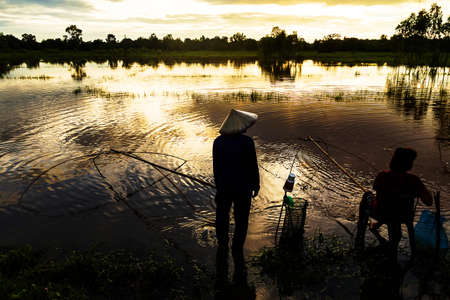 Silhouette of native thai style fish catching