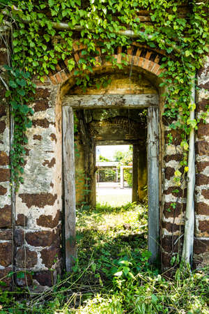 Door frame of the old ruined building photo