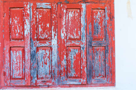 Red wooden window with white wall Stock Photo - 21603122