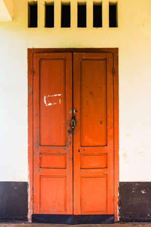 red doors set in a white wall